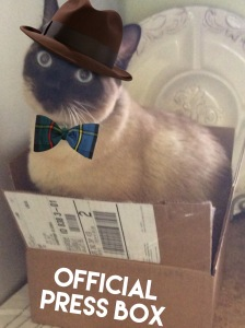 Siamese cat with hat and bow tie