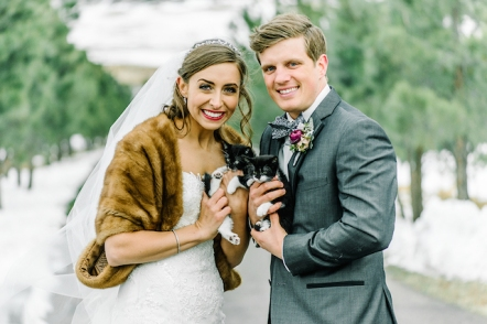 bride and groom holding tuxedo kittens