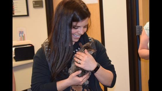 student cuddling kitten